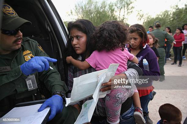 Immigrant Melida Patricio Castro from Honduras shows a birth certificate for her daughter Maria Celeste to a US Border Patrol agent near the USMexico...