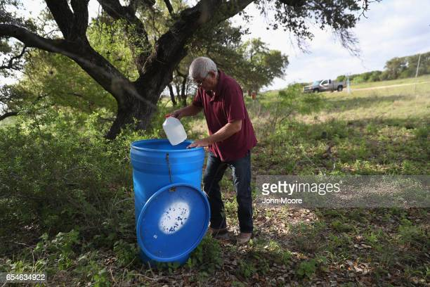 Immigrant rights activist Eddie Canales stocks remote water stations along migrant trails on March 17 2017 near Falfurrias Brooks County Texas...