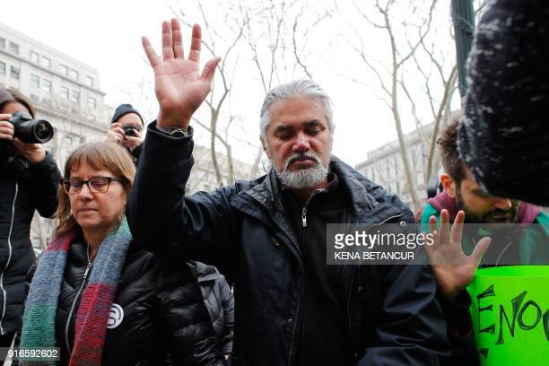 Immigrant rights activist Ravi Ragbir and his wife Amy Gottlieb pray in front of the Immigration building during a Rally a day after he granted...