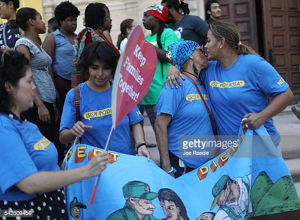 Immigrant rights advocates worker's unions and allied organizations join with immigrant families on the steps of the Freedom Tower to speak to the...