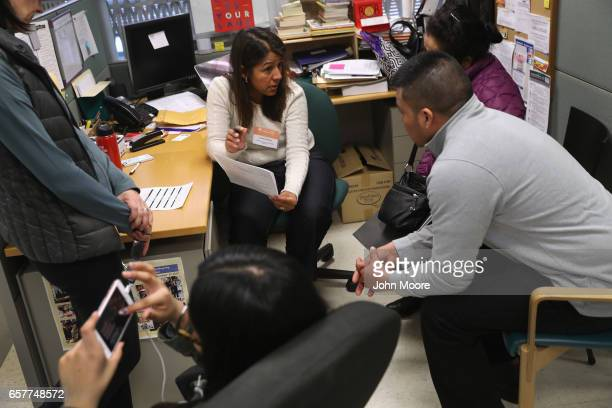 Immigrant services staffer Lorely Peche speaks with immigrant parents fearing deportation on March 25 2017 in Stamford Connecticut The nonprofit...