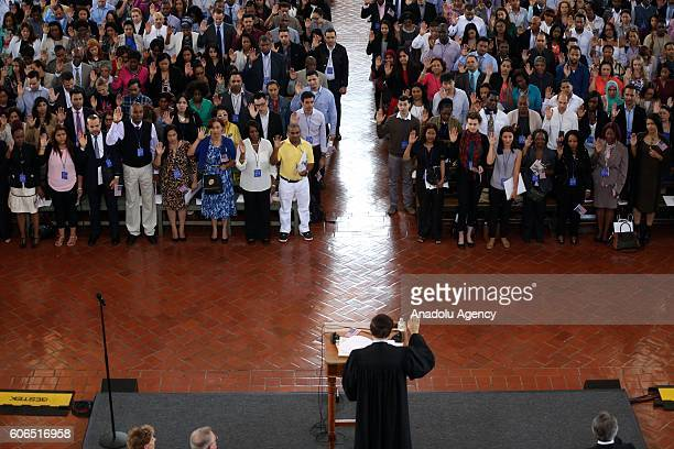 SEPTEMBER 16 2016 Immigrant take the oath of American citizenship in the Great Hall of Ellis Island on September 16 2016 in New York City