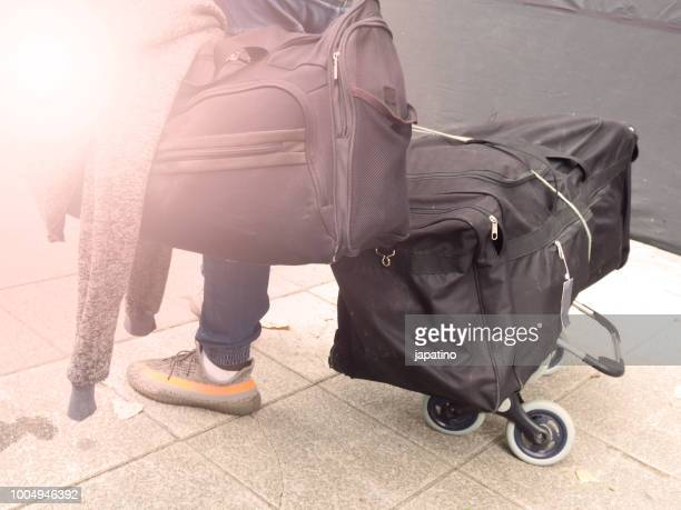 immigrant with all his belongings in two bags - deportation stock pictures, royalty-free photos & images