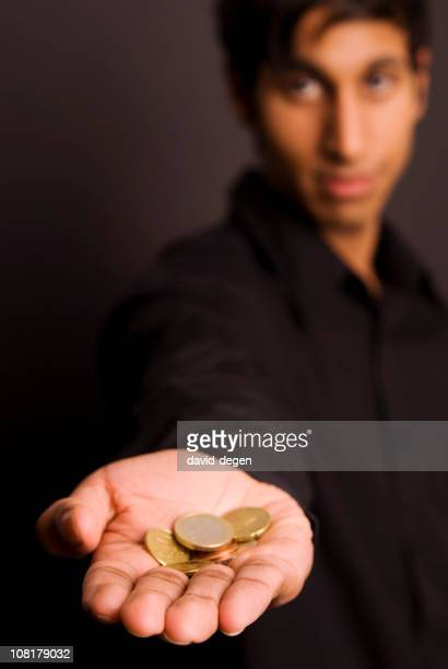 Immigrant With Money In His Open Hand