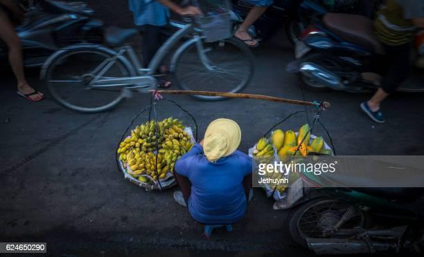 Immigrant woman earn money by banana street vendor