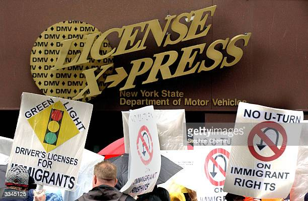 Immigrants and community leaders protest the New York State Department of Motor Vehicles policies that deny driver's licenses and state ID's to...