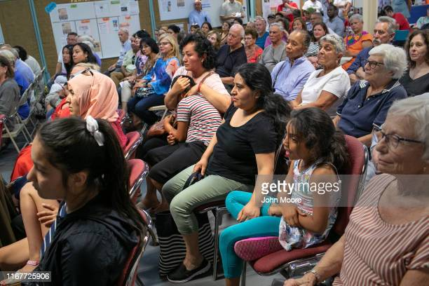Immigrants and other local residents listen attend a town hall styleevent held to reassure the nervous immigrant community on August 12 2019 in...