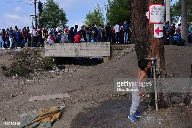 Immigrants and refugees approach the Greece Macedonian border to Gevegelia where they hope to get a train to take them to Serbian border on August 24...