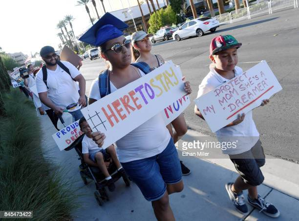 Immigrants and supporters march across the street from the Trump International Hotel Tower Las Vegas during a 'We Rise for the Dream' rally to oppose...