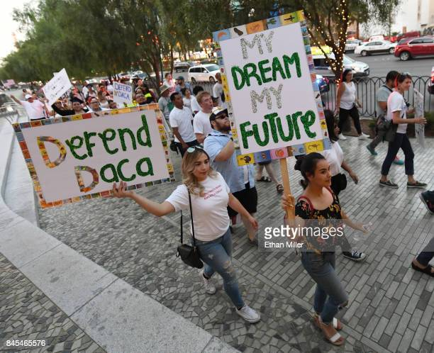 Immigrants and supporters march on the Las Vegas Strip during a We Rise for the Dream rally to oppose US President Donald Trump's order to end DACA...