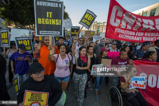 Immigrants and supporters rally and march in opposition to the President Trump order to end DACA on September 5 2017 in Los Angeles United States The...