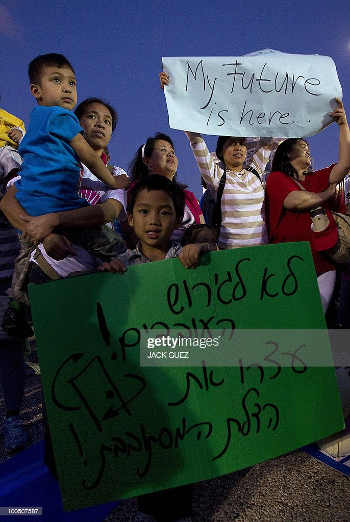 Immigrants and their children hold signs against deportation during a protest in Tel Aviv to ask the Israeli government to allow them to stay in Israel on May 25, 2010.