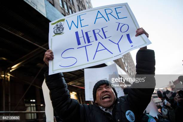 Immigrants and their supporters rally outside of the Varick Street Federal Immigration Court during a protest against recent Immigration and Customs...