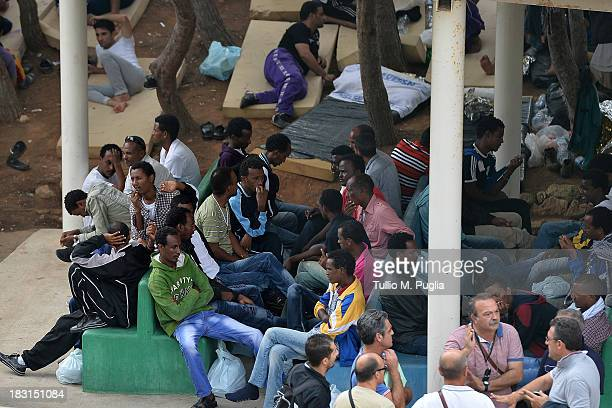 Immigrants are detained after their arrival in the temporary shelter Center on October 4 2013 in Lampedusa Italy The search for bodies continues off...