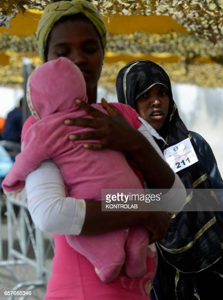 NAPOLI NAPLES CAMPANIA ITALY Immigrants are disembarked in Naples from rescue ship Scirocco Pilot after being saved in Mediterranean sea