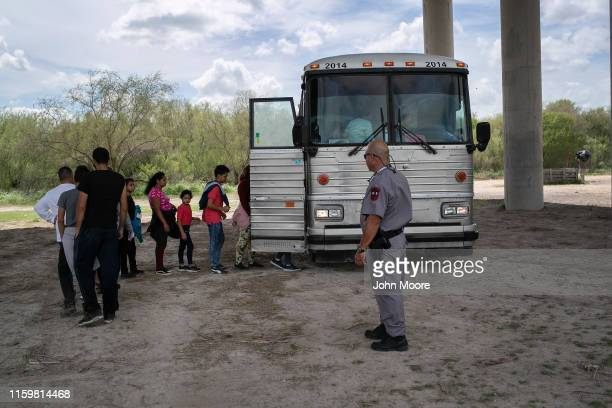 Immigrants are transported to a processing center after they were taken into custody by US Border Patrol agents on July 02 2019 in McAllen Texas The...