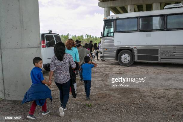 Immigrants are transported to a U.S. Border Patrol processing center after they were taken into custody on July 02, 2019 in McAllen, Texas. The...