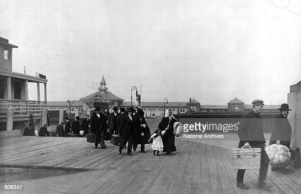 Immigrants arrive at Ellis Island in New York City in 1905