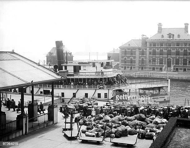 Immigrants arrive at Ellis Island