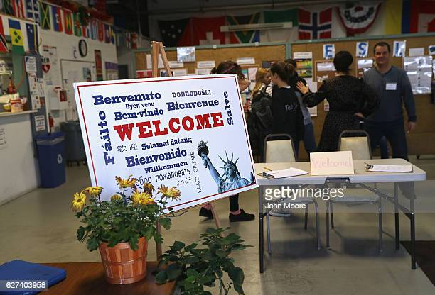 Immigrants arrive to take part in an English as a Second Language class on December 3 2016 at an migrants assistance center in Stamford Connecticut...