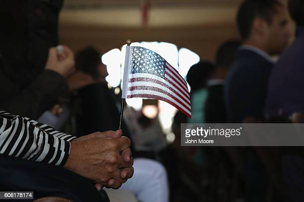 Immigrants become American citizens at a naturalization ceremony on Ellis Island on September 16 2016 in New York City The ceremony marked US...