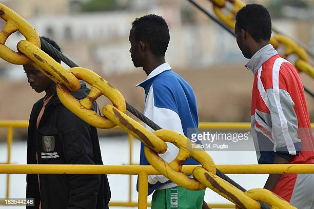 Immigrants board a ship bound for Porto Empedocle Sicily on October 7 2013 in Lampedusa Italy The search for bodies continues off the coast of...