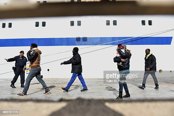 Immigrants board a ship on February 18 2015 in Lampedusa Italy Hundreds of migrants have recently arrived in Lampedusa fleeing the attacks by ISIS in...