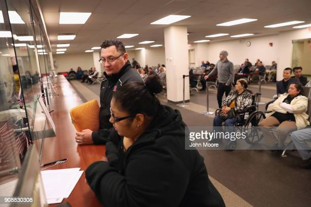 Immigrants fill out documents before a naturalization service on January 22 2018 in Newark New Jersey Although much of the federal government was...