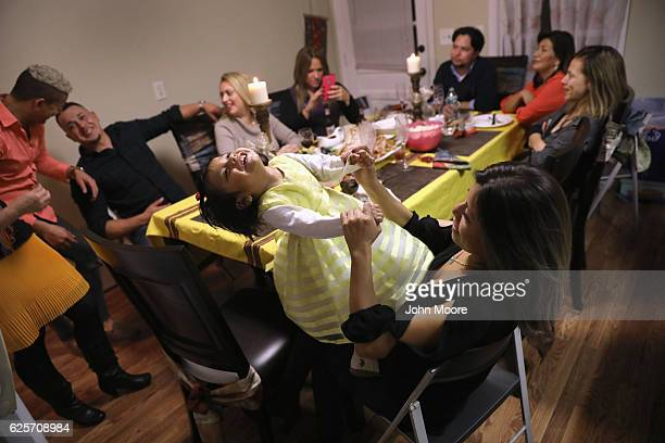 Immigrants from Central America and Mexico celebrate Thanksgiving on November 24 2016 in Stamford Connecticut Family and friends some of them...