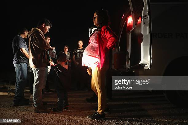 Immigrants from Central America wait to be taken into custody by US Border Patrol agents on August 17 2016 in Roma Texas Thousands of Central...