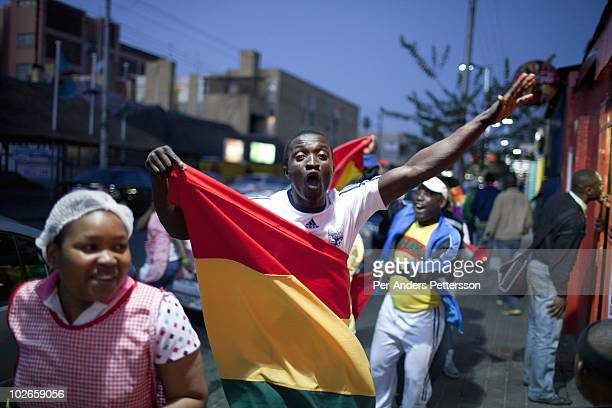 Immigrants from Ghana celebrate in the streets as their team beat Serbia 10 on June 13 in central Yeoville and immigrant suburb in Johannesburg South...