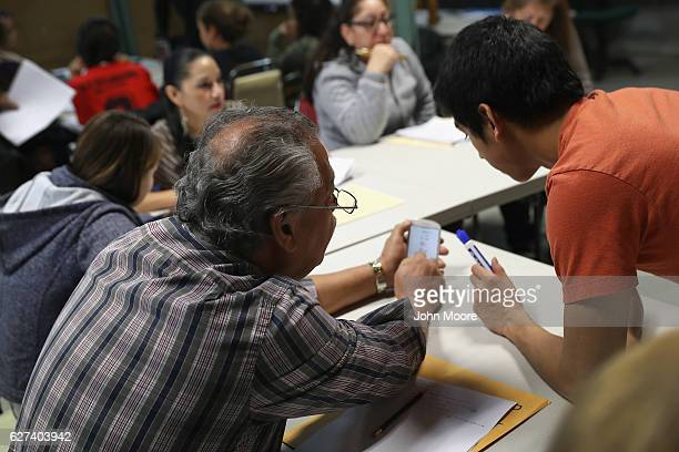 Immigrants from Latin America attend an English as a Second Language class on December 3 2016 at an migrants assistance center in Stamford...