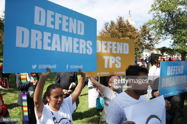 Immigrants gathered at the US Capitol to demand legislative reform to legalize the more than 400000 people with temporary protected status on...