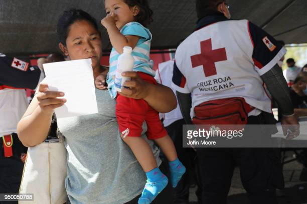 Immigrants get medical attention and perscription drugs at a rest stop on their journey towards the USMexico border on April 22 2018 in Hermosillo...