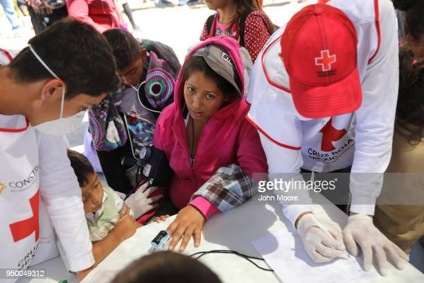 Immigrants get medical attention at a rest stop on their journey towards the USMexico border on April 22 2018 in Hermosillo Mexico Some 600...