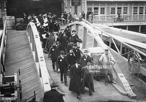 Immigrants leaving Ellis Island Photograph CA 19091910