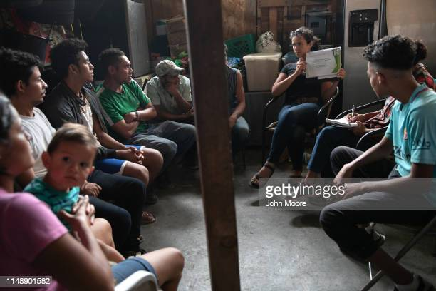 Immigrants listen as American activist Ana Alderstein holds an educational session on US political asylum while at an immigrant shelter on May 09...