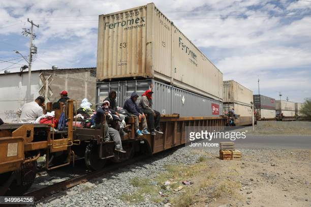 Immigrants most from Central America ride a freight train north to the USMexico border on April 21 2018 in Hermosillo Mexico Some 600 immigrants part...