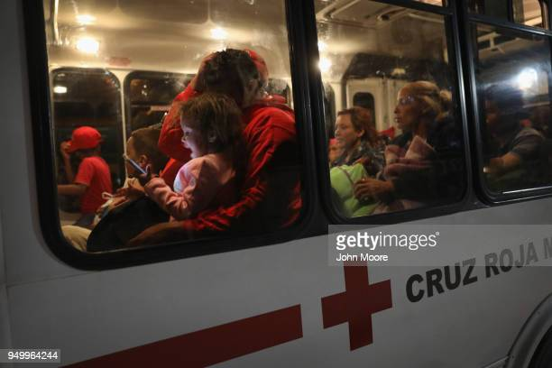 Immigrants most of them from Central America are transported to a shelter after traveling by freight train on their journey towards the USMexico...