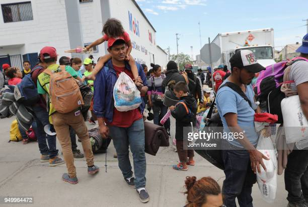 Immigrants most of them from Central America arrive by freight train for a rest stop on their journey to the USMexico border on April 21 2018 in...