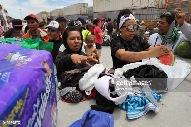 Immigrants most of them from Central America line up for fresh fruit and clean undergarments while pausing on their journey to the USMexico border on...