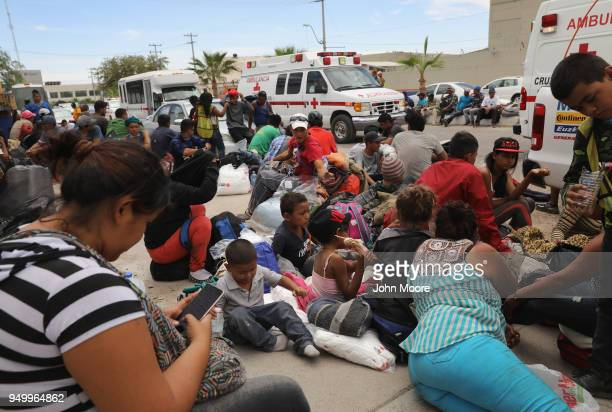 Immigrants most of them from Central America pause at a rest stop after traveling by freight train on their journey towards the USMexico border on...