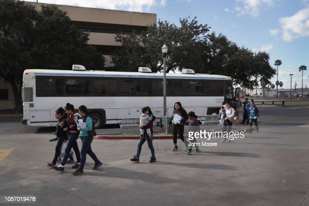 Immigrants, most seeking political asylum, are dropped off at a bus station after being released from U.S. Government detention on November 3, 2018...
