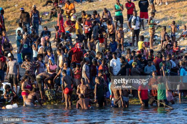 Immigrants, mostly from Haiti gather to bathe on the bank of the Rio Grande on September 19, 2021 in Del Rio, Texas as seen from Ciudad Acuna,...