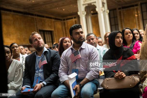Immigrants participate in a naturalization ceremony to officially become US citizens at the New York Public Library July 3 2018 in New York City 200...