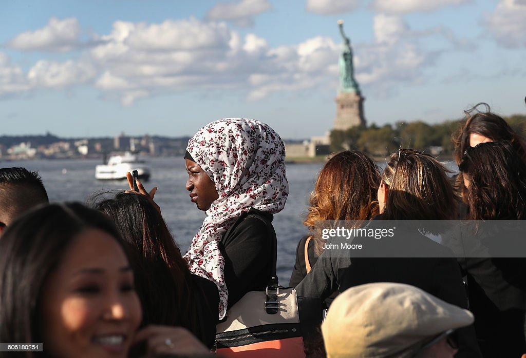 Immigrants pass near the Statue of Liberty while in route to Ellis Island for a naturalization ceremony on September 16, 2016 in New York City. The ceremony marked U.S. Constitution and Citizenship Day, which is September 17. According to U.S. Citizenship and Immigration Services (USCIS), some 38,000 people nationwide are becoming American citizens in 240 ceremonies nationwide this week, the most of any period in 2016.