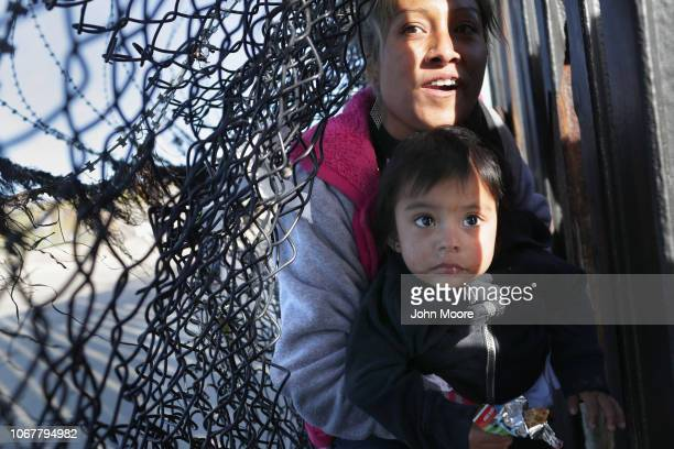 Immigrants pass through a breach in the USMexico border fence on December 2 2018 in Tijuana Mexico More than a dozen migrants went from Tijuana to...