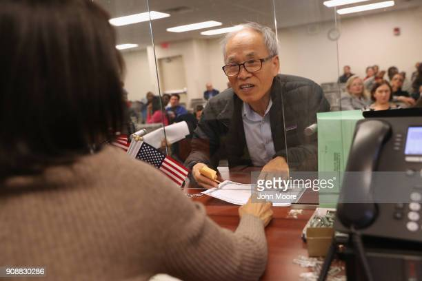Immigrants prepare to become American citizens before a naturalization service on January 22 2018 in Newark New Jersey Although much of the federal...