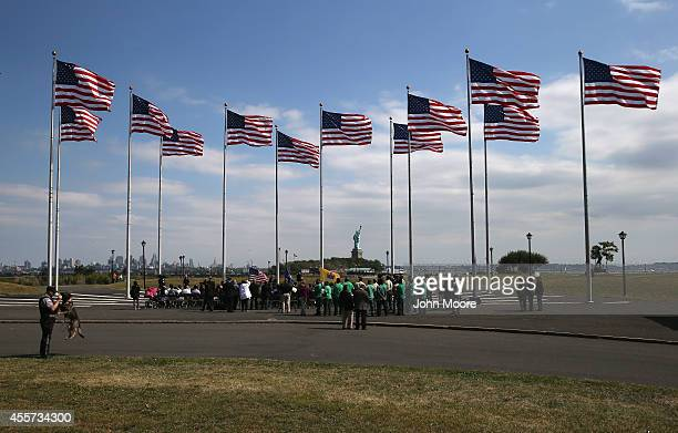 Immigrants prepare to take the oath of citizenship to the United States at a naturalization ceremony at Liberty State Park on September 19 2014 in...