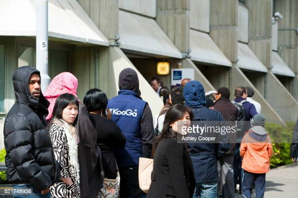 Immigrants queueing up at the UK Border Agency offices in London, UK.